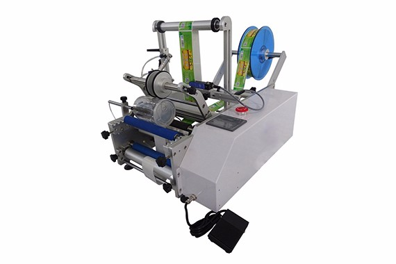Self adhesive round bottle labeler machine